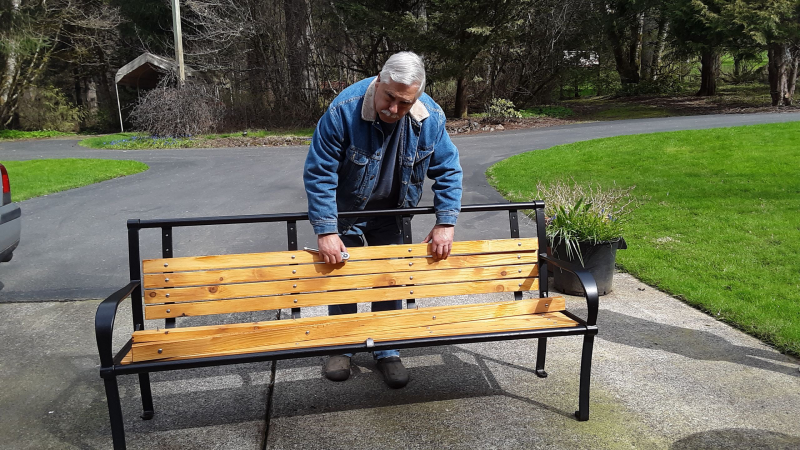 March 2020: During COVID-19, Terry Reddish is working on the benches for Main Street