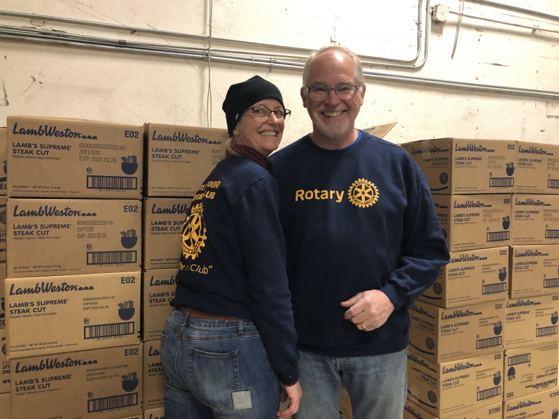 March 2020:  Becky and Dan Hanenkrat at work packing emergency food boxes for Clark County Food bank